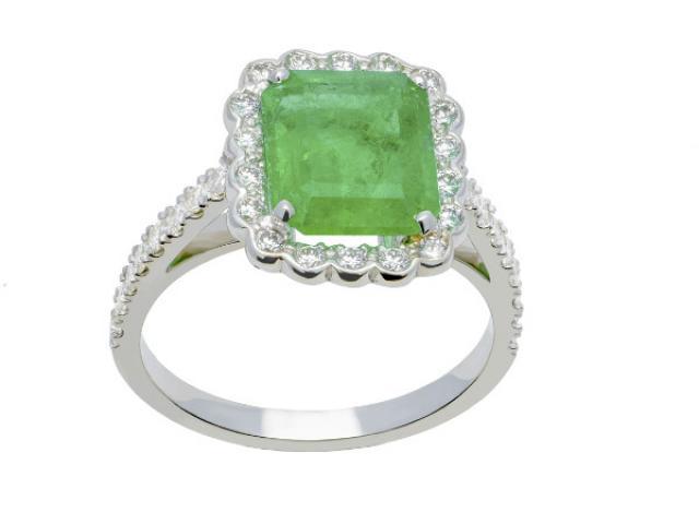 Bague en or 18 carats sertie une emeraude de 3,12 carats et de 0,70 ct diamants